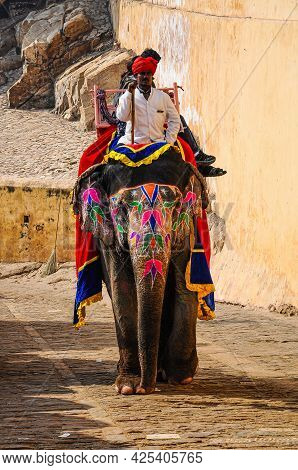 Jaipur, India - Jan 05, 2020: Tourists Ride On Decorated Elephants To Amber Fort In Jaipur, Rajastha