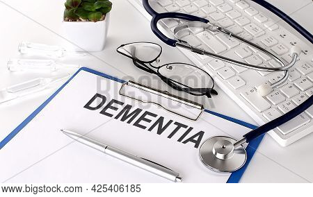 Dementia Text On White Paper On The White Background. Stethoscope ,glasses And Keyboard