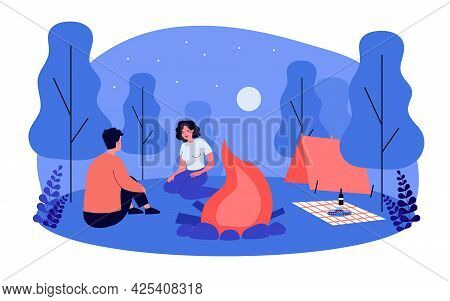 Cute Couple Having Picnic Date At Campsite At Night. Boyfriend And Girlfriend Sitting By Campfire Fl