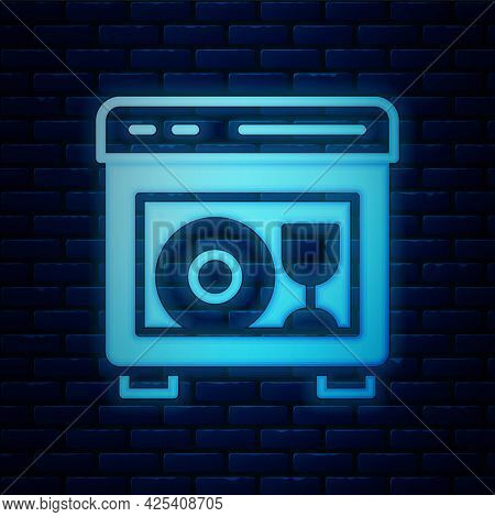 Glowing Neon Kitchen Dishwasher Machine Icon Isolated On Brick Wall Background. Vector