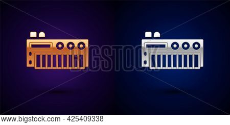 Gold And Silver Music Synthesizer Icon Isolated On Black Background. Electronic Piano. Vector