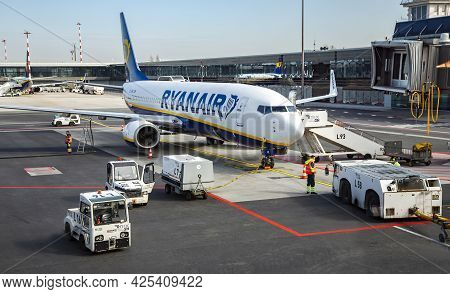 Latvia, Riga, March, 2021 - Airplane Preparation To Fly Early Morning And Loading The Airplane With