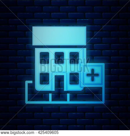 Glowing Neon Medical Hospital Building With Cross Icon Isolated On Brick Wall Background. Medical Ce