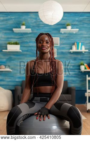 Happy Joyful Smiling African Woman Relaxing On Swiss Ball, After Intense Hard Sport Workout On Yoga