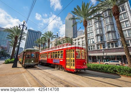 New Orleans, Louisiana, USA downtown cityscape with and trollies.