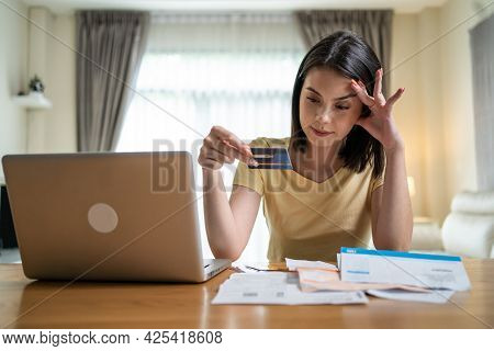 Depressed Asian Young Girl Feel Worry About Financial Problem In House. Stressed Desperate Young Wom