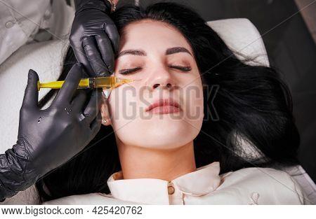 Close-up Snapshot Of Plasmolifting Procedure Injection. Plasma Injection Into Skin Under Eyes Of Pat
