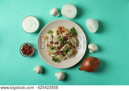 Concept Of Tasty Food With Vareniki Or Pierogi On Mint Background