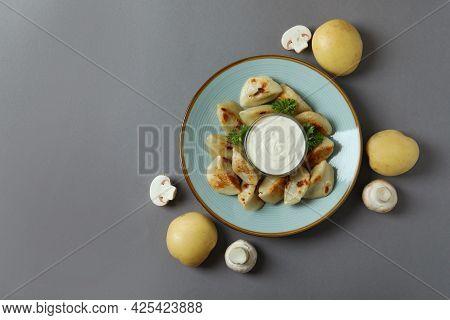 Concept Of Tasty Food With Vareniki Or Pierogi On Gray Background