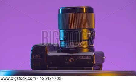 Russia, Moscow - May 5, 2021: New Professional Camera Lens On Isolated Background. Action. New Profe