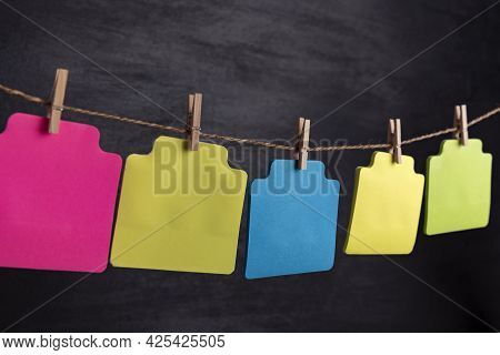 Multicolored Blank Paper Cards Hang With Clothespin On Rope. Copy Space. Place For Your Text