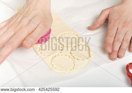 Female Hands, Cookie Cutters And Dough. Chef Prepares Cookies. Process Of Making Homemade Cookies