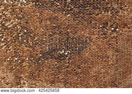 Golden Shiny Background, Fabric Background With Sparkle. Sequins On The Textile