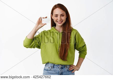 Image Of Smiling Redhead Woman Showing Small Size, Little Tiny Thing And Looking Happy At Camera, St