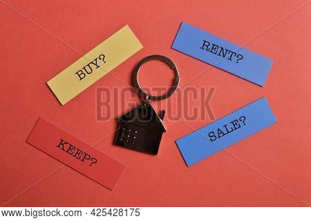 House Keychain And Memo Note Written With Buy? Rent? Keep? Sale?. Property Concept.