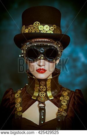 Fantasy world, scientific inventions. Portrait of a beautiful victorian steampunk lady on a grunge background.