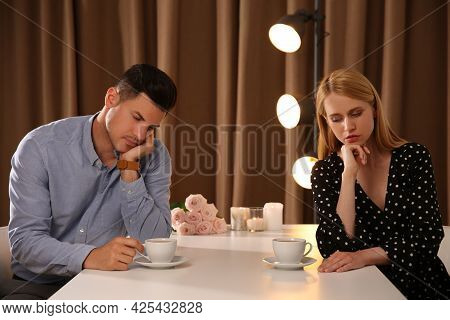Displeased Man And Young Woman In Restaurant. Failed First Date