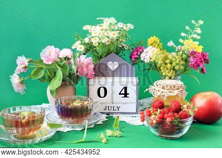 Calendar For July 4 : The Name Of The Month Of July In English, Cubes With The Numbers 0 And 4, Bouq