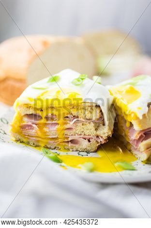 French Ham And Cheese Sandwich With A Fried Egg On Top