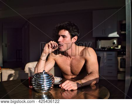 Attractive Shirtless Young Man Eating Breakfast At Home