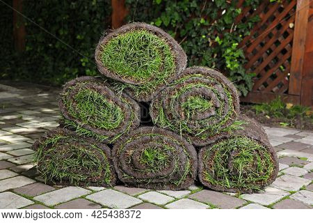 Rolls Of Sod With Grass On Backyard