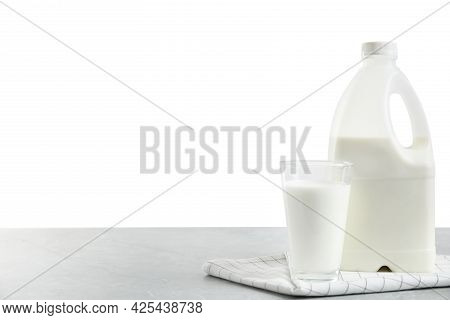 Gallon Bottle Of Milk And Glass On Light Grey Table. Space For Text. Space For Text
