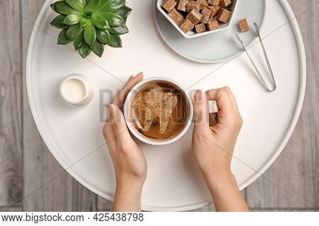 Coffee Causing Dental Problem. Woman With Cup Of Hot Drink At Table, Top View