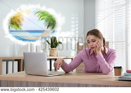 Young Woman Dreaming About Vacation At Table In Office