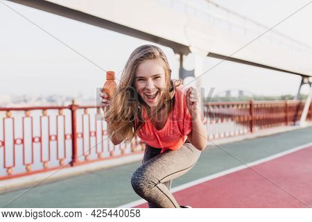 Ecstatic White Girl Having Fun During Summer Marathon. Outdoor Portrait Of Inspired Female Model Pos