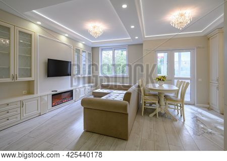 Modern large bright luxurious kitchen and dining room in studio apartment interior