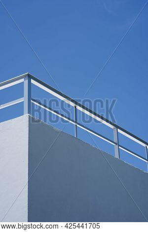 Metal Railing On The Roof Of A Building Against The Blue Sky, Isla Mujeres, Mexico.