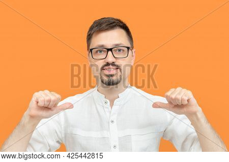 Bearded Caucasian Man In Eyeglasses Indicating Himself With Fingers. Handsome Guy Looking Confident