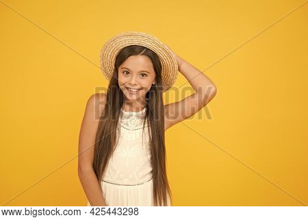 Enjoying Summer. Long-awaited Summer Vacation. Happy Childhood. Cheerful Little Girl Wear Straw Hat.