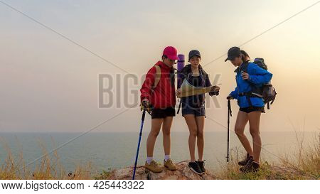 Group Asia Friends Traveler With Backpack Adventure Holding Map To Find Directions And Walking Relax