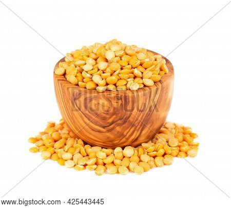 Dry Yellow Split Peas In Olive Bowl, Isolated On White Background. Halves Of Yellow Legume Peas.
