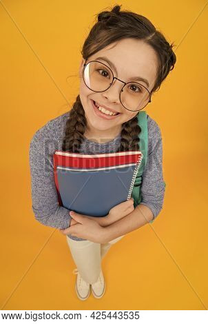 What Would You Like To Read. Happy Library Reader Yellow Background. Little Girl Hold Library Books.