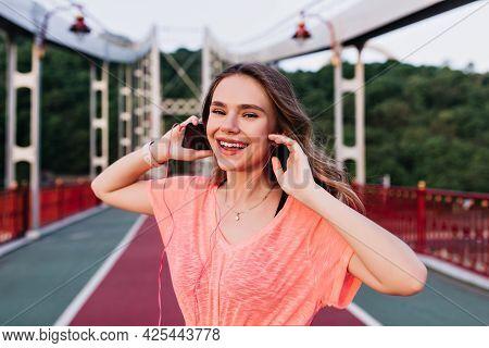 Emotional Girl In Pink T-shirt Enjoying Favorite Song After Training. Adorable Caucasian Woman Prepa