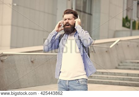 Cause The Streets Are Singing. Happy Hipster Sing Song Urban Outdoors. Bearded Man Enjoy Singing In