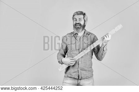 Tool For Graphics. Mature Bearded Man Hold Measuring Ruler. Study At Home. Education. School Teacher
