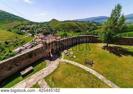 Esplanade Of The Castle Inside The Wall And Town At The Bottom In The Valley. Argueso Santander.