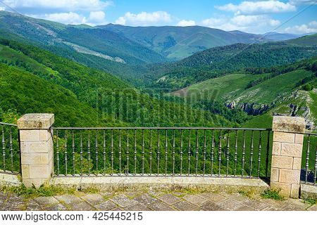 Viewpoint With Iron Fence To The Green Landscape Of The Lush Valley. Santander.