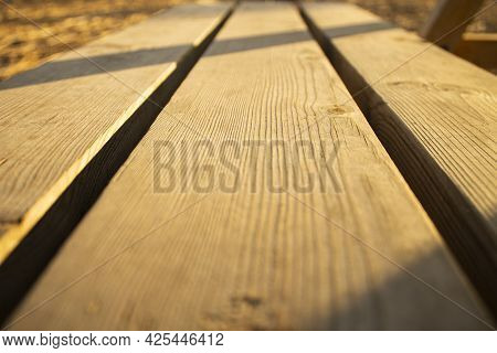 Table In The Park.park Bench Made Of Wood.closeup Of The Wood In A Park.closeup Of A Park Bench.park
