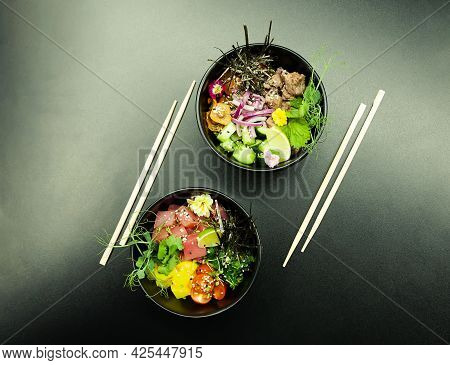Poke Salads With Tuna And Beef In Bowls On The Table. Two Bowls Of Poke Salad With Chopsticks On A G
