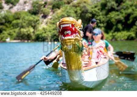 Close-up Of Dragon Boat With Sport Crew