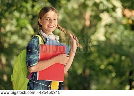 Girly Things. Happy Child Hold Hair Plait Outdoors. Beauty School. Hairstylist Education. Hairdressi