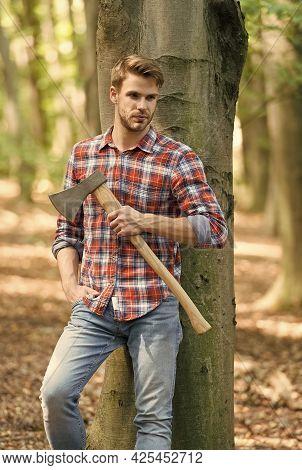 Having A Little Break. Lumberjack Holding Ax In Hands. Wanderlust, Hiking And Travel. Tree Cutter Wi