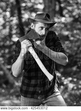 Poacher In Forest. Deforestation. Ranger Or Poach. Man Forester Use Axe. Search Firewood For Picnic