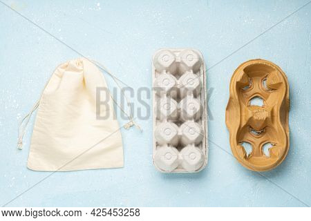 Eco Package For Eggs, Coffee And Cotton Bag On Blue Cement Background.zero Waste Cconcept. Package-f