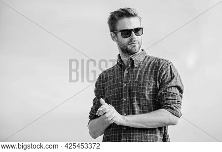 Man Eyewear Model Outdoors Blue Sky Background. Handsome Guy Wear Sunglasses. Perfect Vision. Eyes H