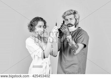 Vaccine In Syringe. Medical Couple Use Syringe Vaccination. Say No To Coronavirus. Virus Remedy Inje